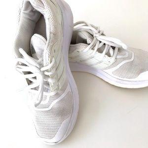 White women's Adidas sneakers